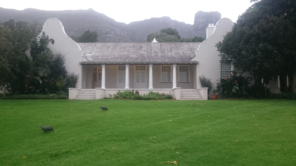 Kirstenbosch Manor Guest House nestled into the top of the garden with Table Mountain in the background